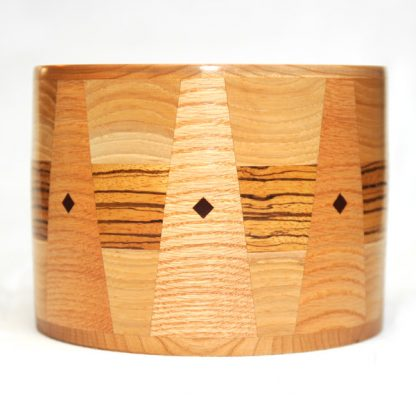 Round Cremation Urn in Maple and Zebrawood