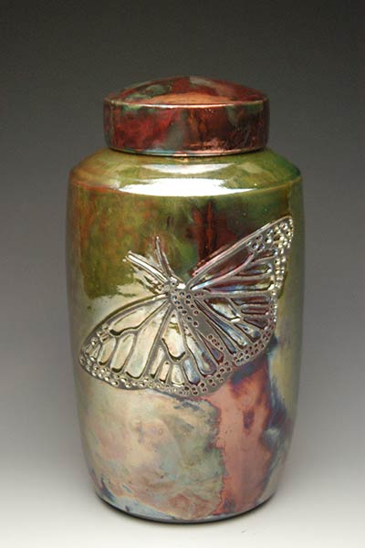 Hand made Raku ceramic urn with Butterfly