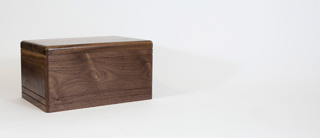 Boxwood companion urn in walnut wood