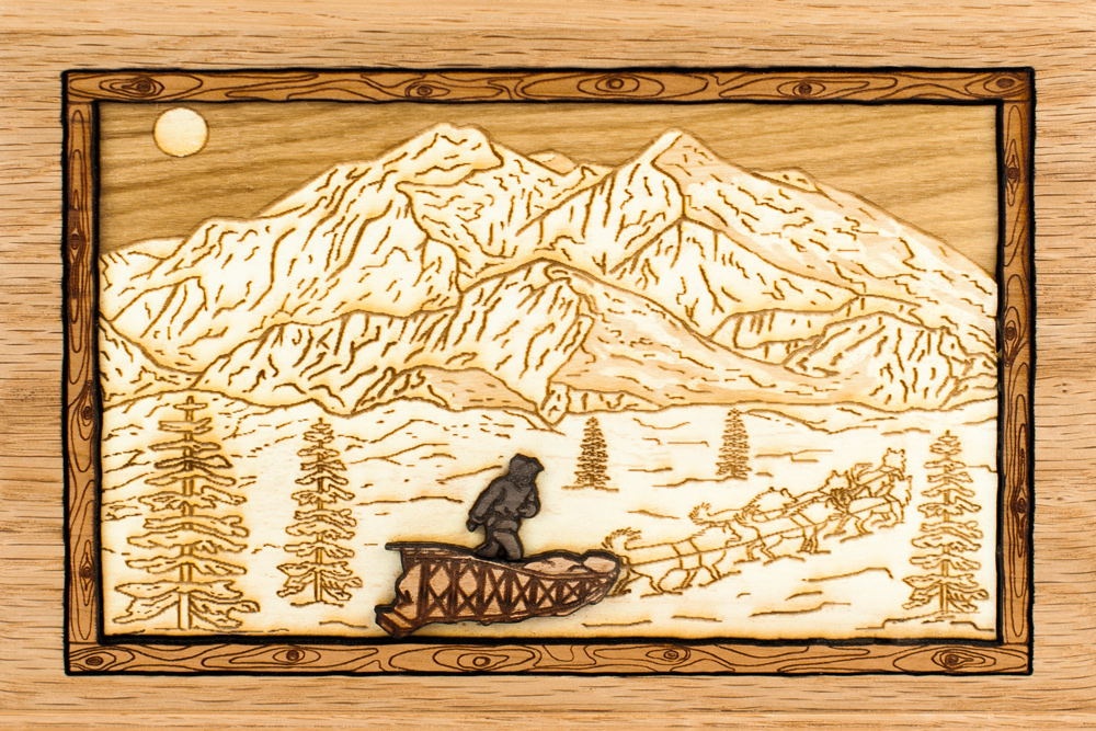 Wood art dog sledding cremation urn