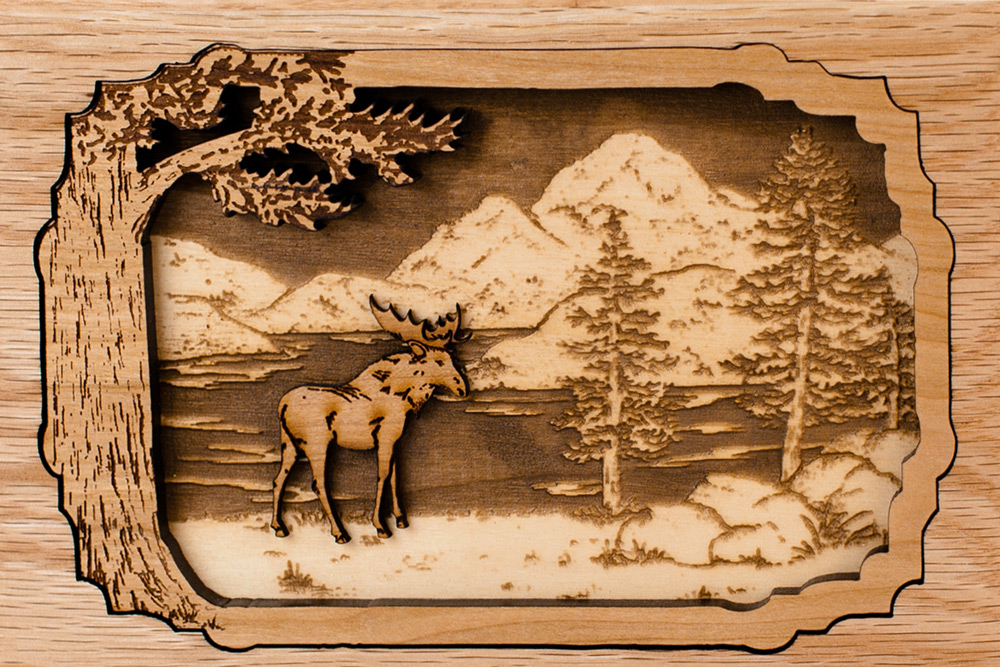 Wooden inlay art scene of moose in forest