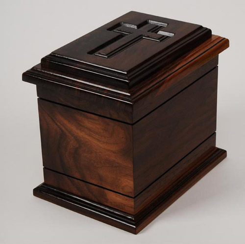 Walnut funeral urn with cross