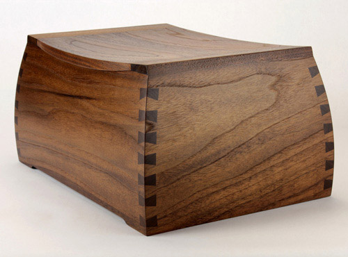 A shapely wood cremation urn