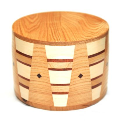 Round Cremation Urn in Oak, Padauk, Hickory Wood