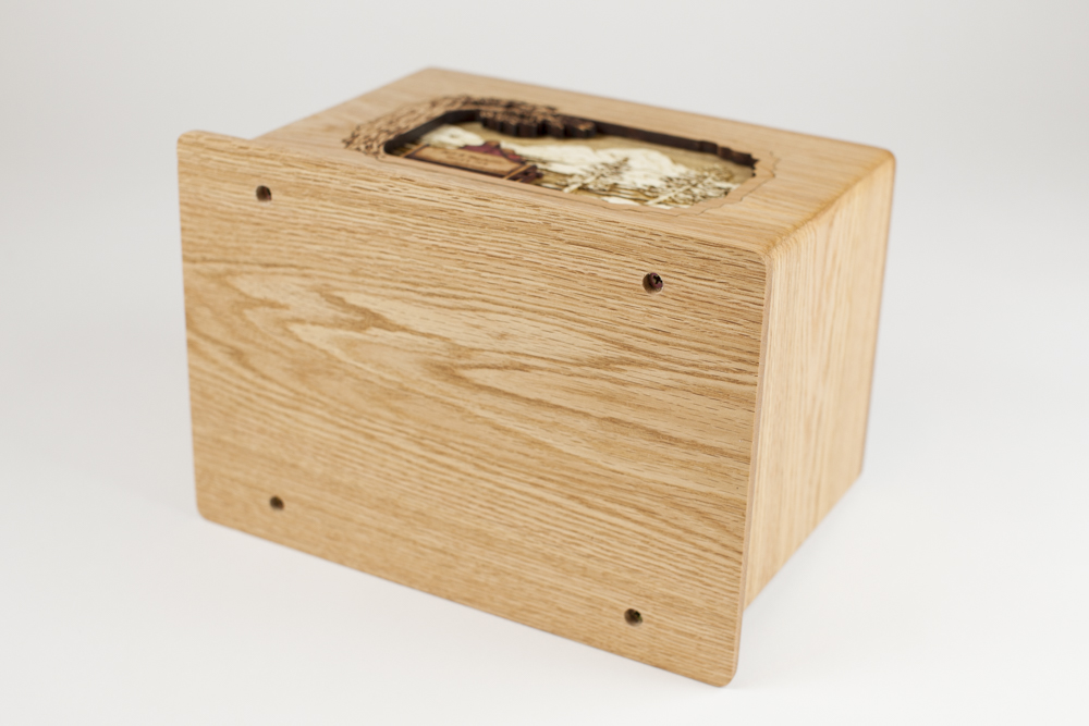Cremation urn interior is accessed from bottom panel