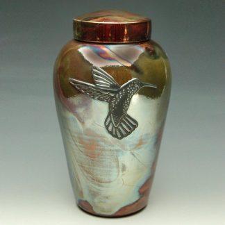 One of a kind raku ceramic urn with a hummingbird emblem
