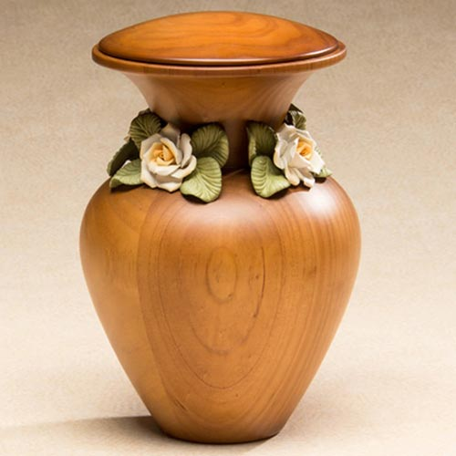 Wood urn with ceramic white roses