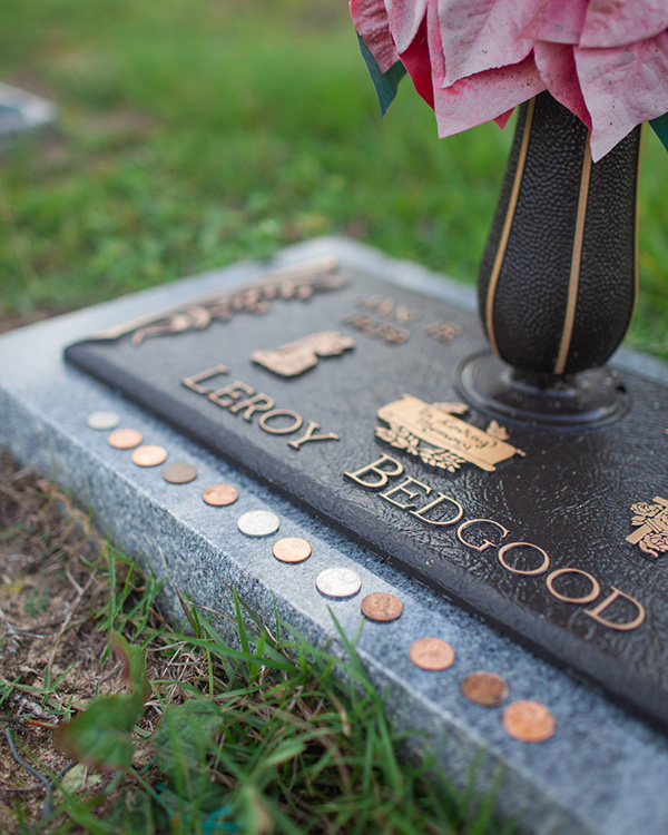 Leaving Coins at the Cemetery