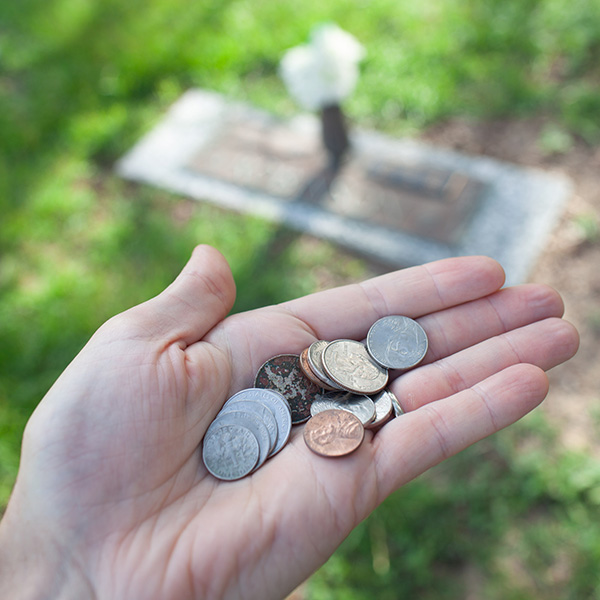 Leaving Coins at the Cemetery (Practice - Tradition)